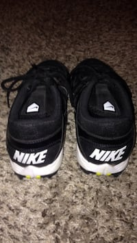 pair of black Nike low-top cleats  Oklahoma City