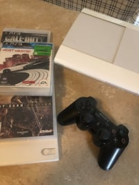 black Sony PS3 slim console with controller and game cases Mississauga, L5W