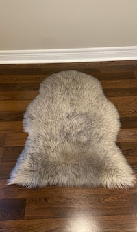Beautiful faux fur area rug or throw over