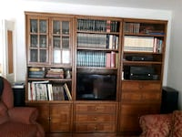 brown wooden TV hutch with flat screen television 797 km