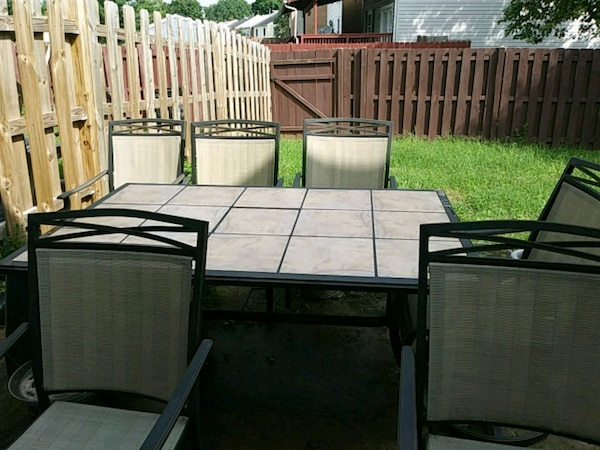 black patio table set with inlaid removable tiles
