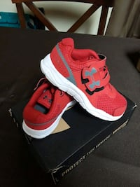pair of red-and-white Nike running shoes 693 mi