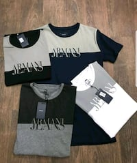 four assorted-color Armani Jeans crew-neck t-shirts London