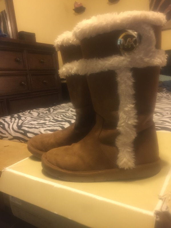 pair of brown Michael Kors suede sheepskin boots with box