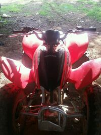 red and black all-terrain vehicle Honda 90 g