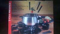 never used 15 piece stainless steel fondue set