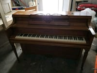 brown and white upright piano Quincy, 02170