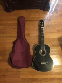 New black guitar with case Springfield, 22150