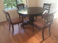 Round brown wooden table with four chairs dining set San Diego, 92129