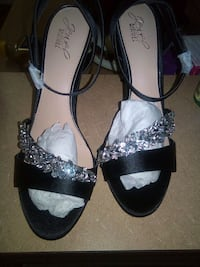 pair of black-and-white sandals Buford, 30519