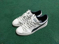 white-and-black Puma low top sneakers