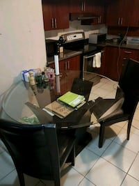 Glass kitchen table with 4 leather back chairs Brampton, L6T