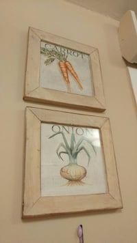two square white wood-framed carrot and onion paintings