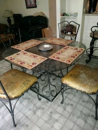 Wrought iron dining table and chairs  Richmond, 77469