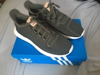 Pair of green adidas running shoes with box 2412 mi
