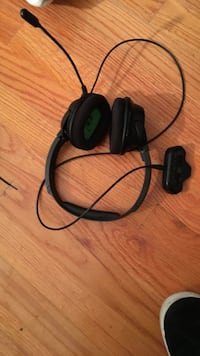 black and green corded headset
