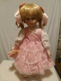 World market bisque doll with teddy bear