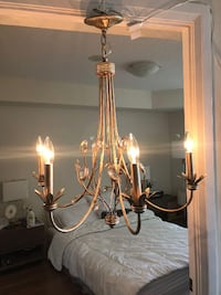 brass-colored uplight chandelier null