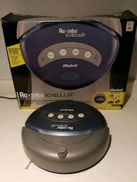 black and gray iRobot Roomba vacuum cleaner with b Shelby charter Township, 48315