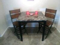 rectangular brown wooden table with four chairs dining set Round Rock, 78681