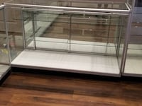Two gray metal framed glass display case Victoria, V9A 7K7