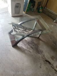 rectangular glass-top table with brown wooden base