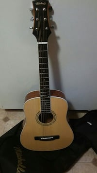 brown Mitchell acoustic guitar