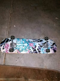 white, blue, and pink skateboard North Las Vegas, 89084
