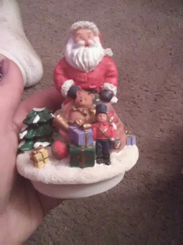 red and white Santa Claus ceramic figurine