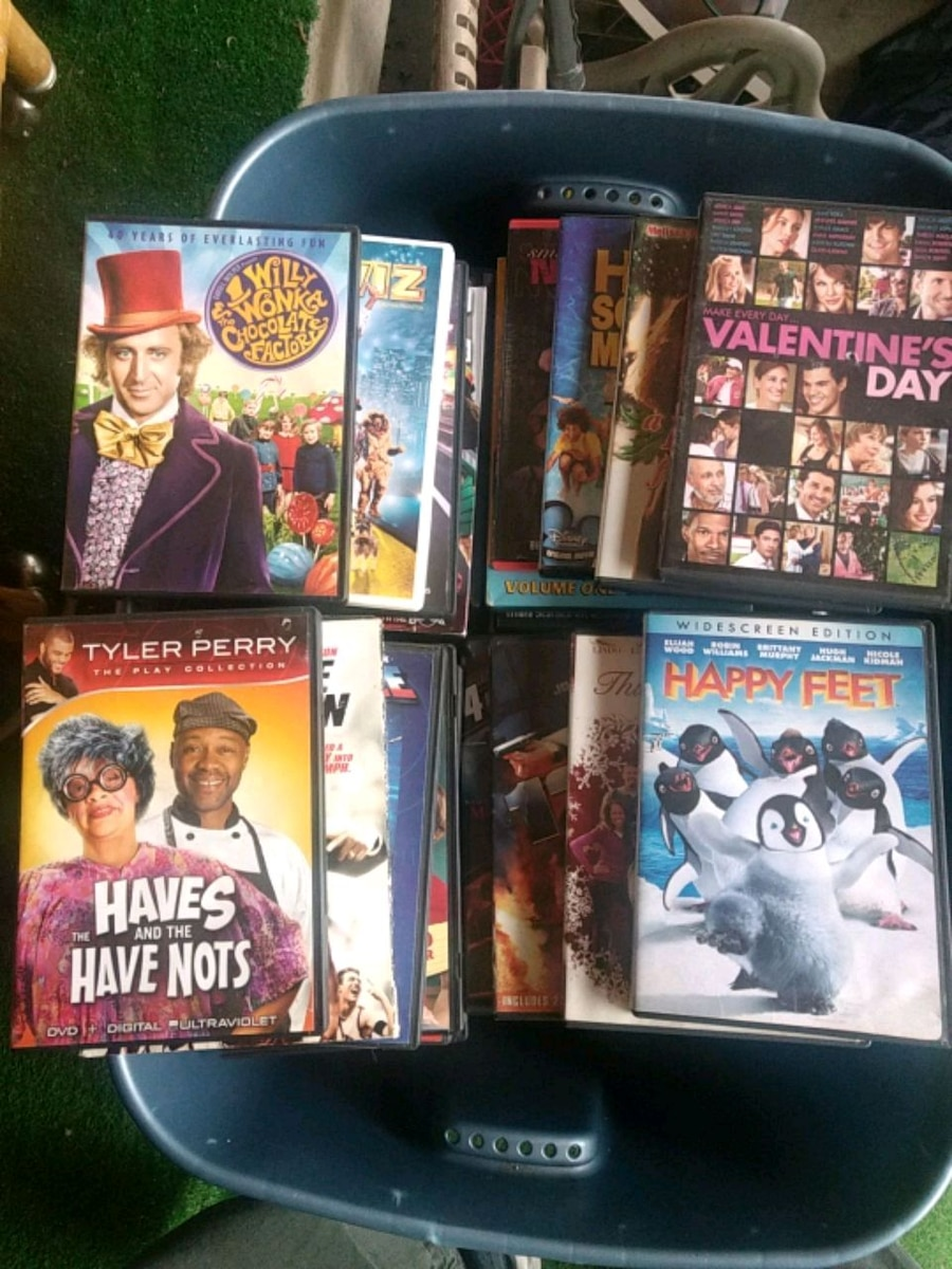 Photo Over 110 Used DVDs / $1.00 Each