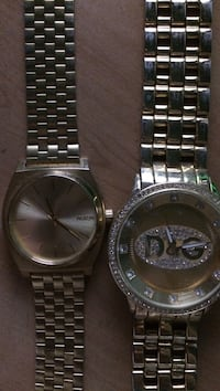two round silver analog watches Central Okanagan, V4T 1S1