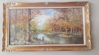 river and forest painting with brown wooden frame