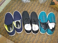 four pairs of assorted color shoes