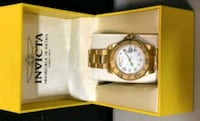 round gold analog watch with gold link bracelet in box Toronto, M2H 2P5