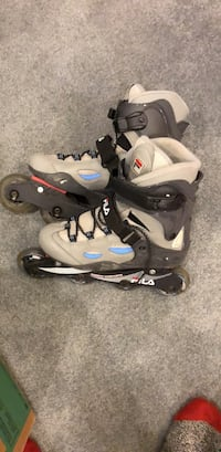 Pair of gray-and-black fila rollerblades Calgary, T3H 3T8