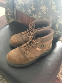 Pair of brown leather lace-up work boots Calgary, T2Y 2V6