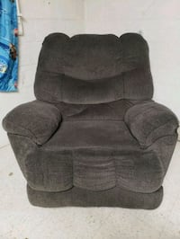 Gray recliner. Few holes, few pulls. Seats nice Stephens City, 22655