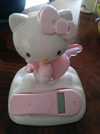 white and pink Hello Kitty home phone