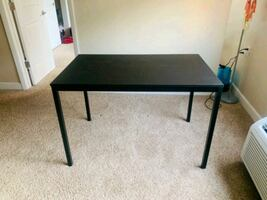 IKEA table with 2 chairs. Like new not a single scratch.