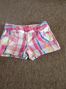 white, pink, and blue plaid shorts