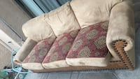 brown and red floral fabric 2-seat sofa