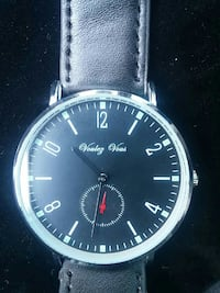 round silver-colored analog watch with black leath Winnipeg, R2H 0Z3