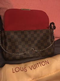 Louis Vuitton cross body purse with magnet closure