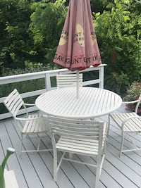 Round white metal table with four chairs patio set
