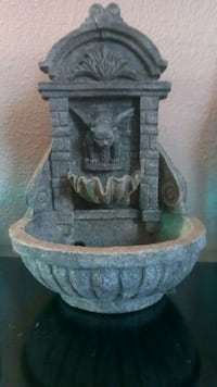 Grey gargoyle fountain. Tacoma