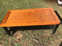 rectangular brown and black wooden coffee table