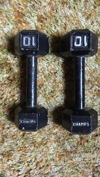 two 10kg black Champs fixed weight dumbbells