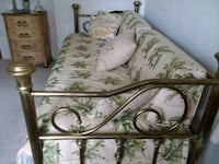 white and green floral fabric sofa