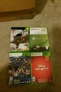 four Xbox 360 game cases Joint Base Andrews, 20762