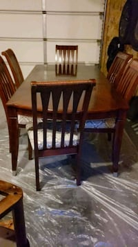 rectangular brown wooden table with six chairs di Edmonton, T6V 1C5
